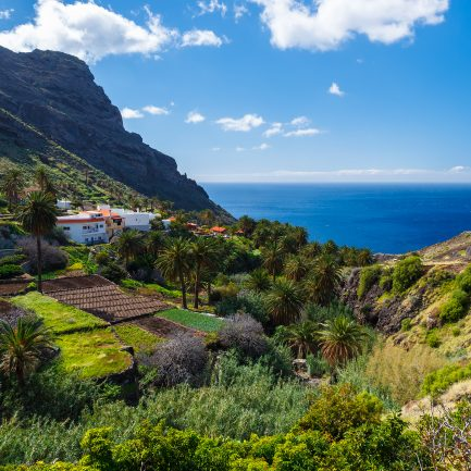 Coast mountain valley ocean view white clouds sunny day, La Gomera, Canary Islands